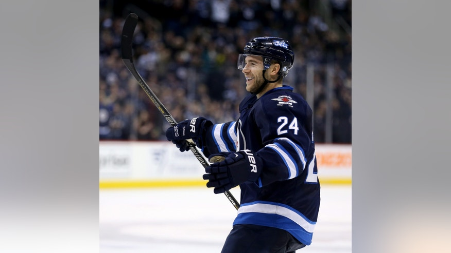 Winnipeg Jets' Grant Clitsome (24) celebrates after scoring a second period goal against the San Jose Sharks' during NHL hockey action in Winnipeg, Manitoba, Sunday, Nov.10, 2013. (AP Photo/The Canadian Press, Trevor Hagan)