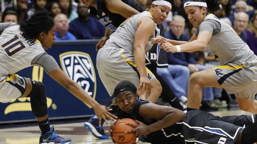 Duke's Elizabeth Williams, front right, holds onto a loose ball between, from left to right, California's Mercedes Jefflo, Mikayla Lyles and Hind Ben Abdelkader during the first half of an NCAA college basketball game on Sunday, Nov. 10, 2013, in Berkeley, Calif. (AP Photo/George Nikitin)