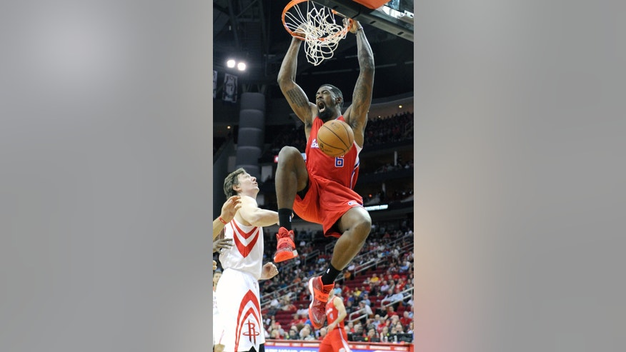 Los Angeles Clippers' DeAndre Jordan (6) dunks the ball over Houston Rockets' Omer Asik in the first half of an NBA basketball game on Saturday, Nov. 9, 2013, in Houston. (AP Photo/Pat Sullivan)