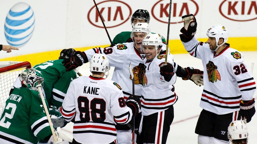 Dallas Stars goalie Kari Lehtonen, left, of Finland, watches as Chicago Blackhawks right wing Patrick Kane (88), center Jonathan Toews, left wing Patrick Sharp (10), defenseman Michal Rozsival (32) of Czech Republic, and defenseman Nick Leddy celebrate Toews' goal during the second period of an NHL hockey game Saturday, Nov. 9, 2013, in Dallas, Texas. (AP Photo/Sharon Ellman)