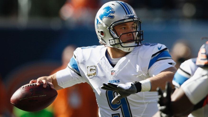 Detroit Lions quarterback Matthew Stafford (9) throws a pass during the first half of an NFL football game against the Chicago Bears, Sunday, Nov. 10, 2013, in Chicago. (AP Photo/Charles Rex Arbogast)