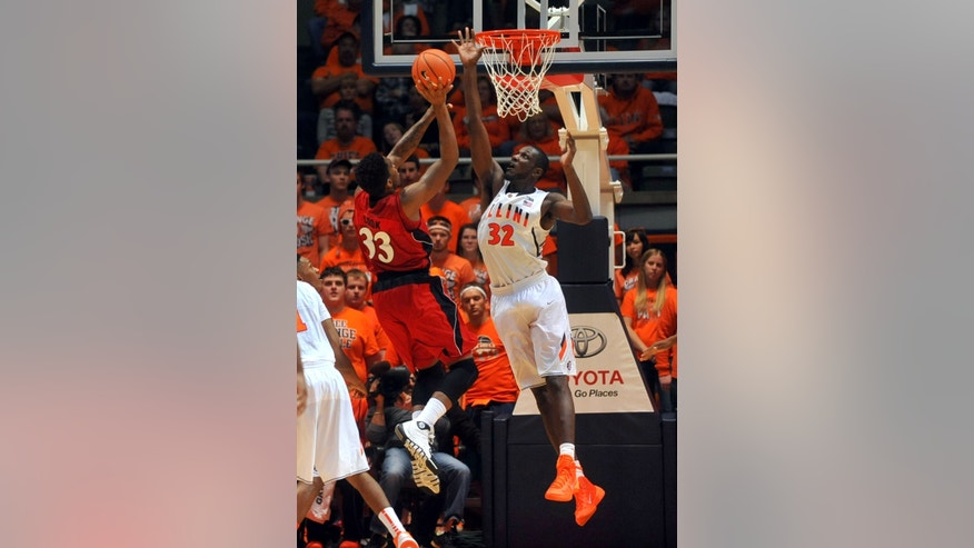Illinois forward/center Nnanna Egwu (32) challenges a shot attempt by Jacksonville State forward Nick Cook (33) in the second half of an NCAA college basketball game Sunday, Nov. 10, 2013, in Champaign, Ill. (AP Photo/Rick Danzl)