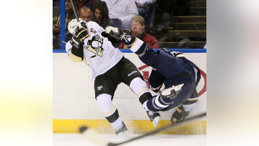 St. Louis Blues defenseman Alex Pietrangelo, right, collides with Pittsburgh Penguins center Sidney Crosby in second-period NHL hockey game action on Saturday, Nov. 9, 2013, in St. Louis. (AP Photo/St. Louis Post-Dispatch, Chris Lee) EDWARDSVILLE OUT; ALTON OUT