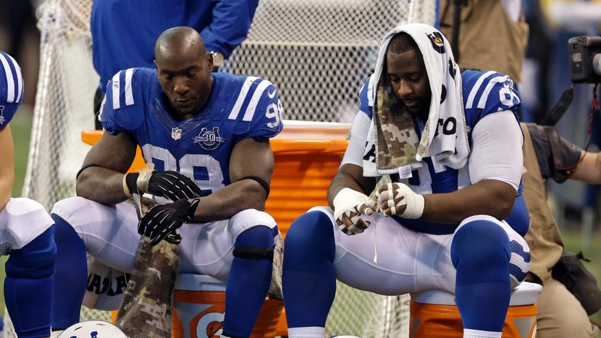 Indianapolis Colts outside linebacker Robert Mathis, left, and nose tackle Aubrayo Franklin sit on the bench in the final minutes of the second half of an NFL football game against the St. Louis Rams in Indianapolis, Sunday, Nov. 10, 2013. The Rams defeated the Colts 38-8. (AP Photo/Darron Cummings)