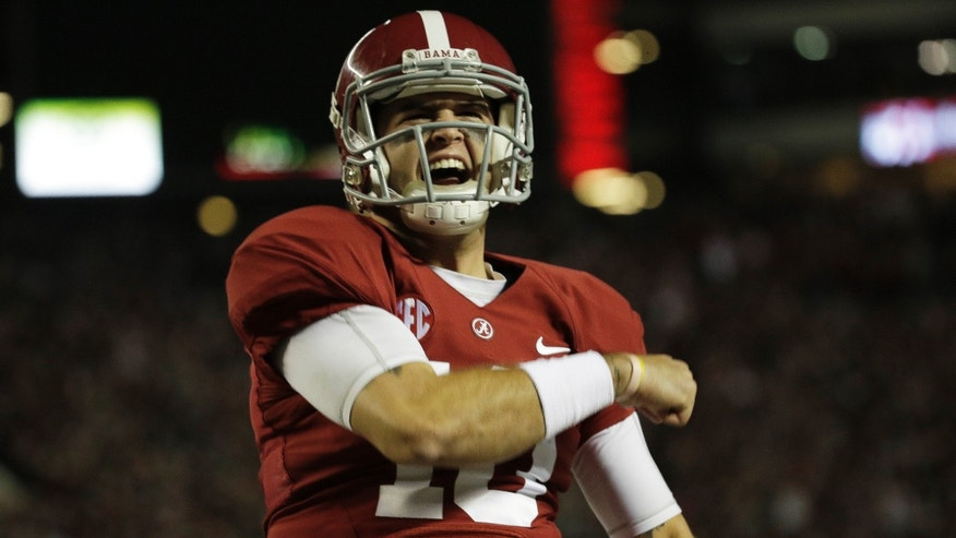 Alabama quarterback AJ McCarron (10) celebrates a touch down scored by Alabama tight end O.J. Howard (88) during the first half of an NCAA college football game against LSU , Saturday, Nov. 9, 2013, in Tuscaloosa, Ala. (AP Photo/Dave Martin)