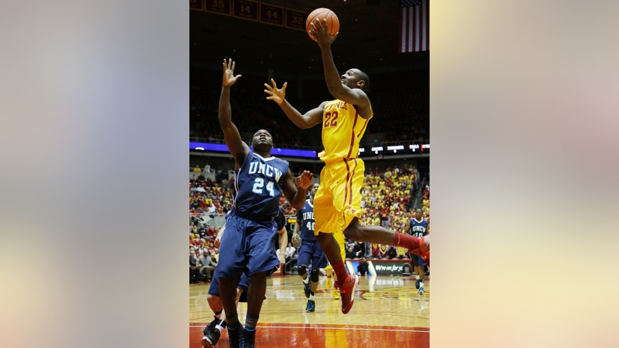 Iowa State forward Dustin Hogue, right, drives to the basket past UNC Wilmington guard Addison Spruill, left, during the first half of an NCAA college basketball game on Sunday, Nov. 10, 2013, in Ames, Iowa. (AP Photo/Charlie Neibergall)