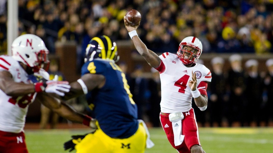 Nebraska quarterback Tommy Armstrong Jr. (4) throws a pass in the third quarter of an NCAA college football game against Michigan in Ann Arbor, Mich., Saturday, Nov. 9, 2013. Nebraska won 17-13. (AP Photo/Tony Ding)