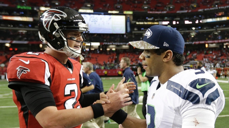 Atlanta Falcons quarterback Matt Ryan (2) speaks with Seattle Seahawks quarterback Russell Wilson (3) after the second half of an NFL football game, Sunday, Nov. 10, 2013, in Atlanta. The Seattle Seahawks won 33-10. (AP Photo/David Goldman)