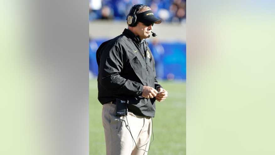 Missouri head coach Gary Pinkel watches his team during the third quarter of an NCAA college football game against Kentucky, Saturday, Nov. 9, 2013, in Lexington, Ky. Missouri won 48-17. (AP Photo/James Crisp)