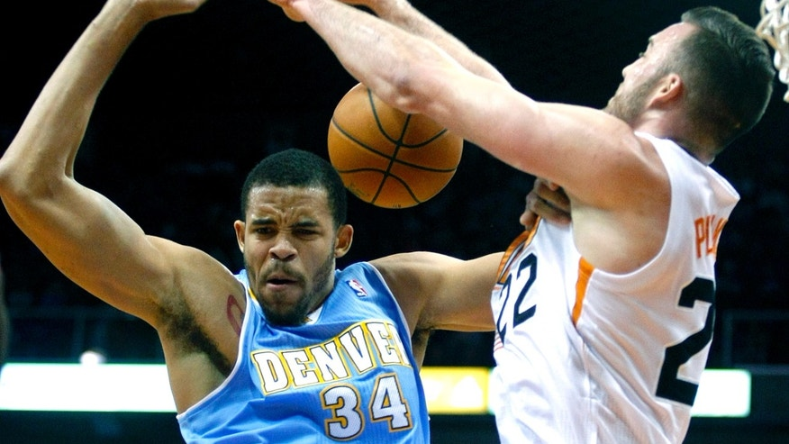 Denver Nuggets center JaVale McGee (34), left, is fouled by Phoenix Suns center Miles Plumlee (22) in the first quarter during an NBA basketball game on Friday, Nov. 8, 2013, in Phoenix. (AP Photo/Rick Scuteri)