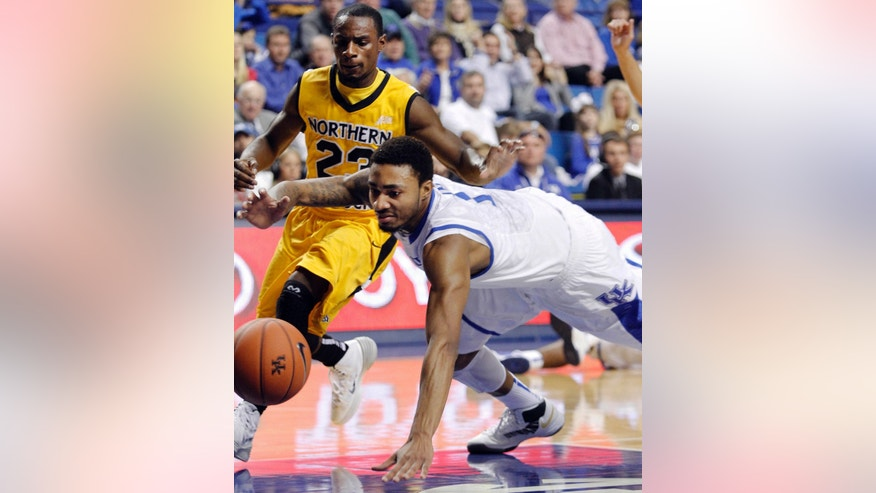 Kentucky's James Young, right, dives for a loose ball in front of Northern Kentucky's Todd Johnson (23) during the first half of an NCAA basketball game, Sunday, Nov. 10, 2013, in Lexington, Ky. (AP Photo/James Crisp)