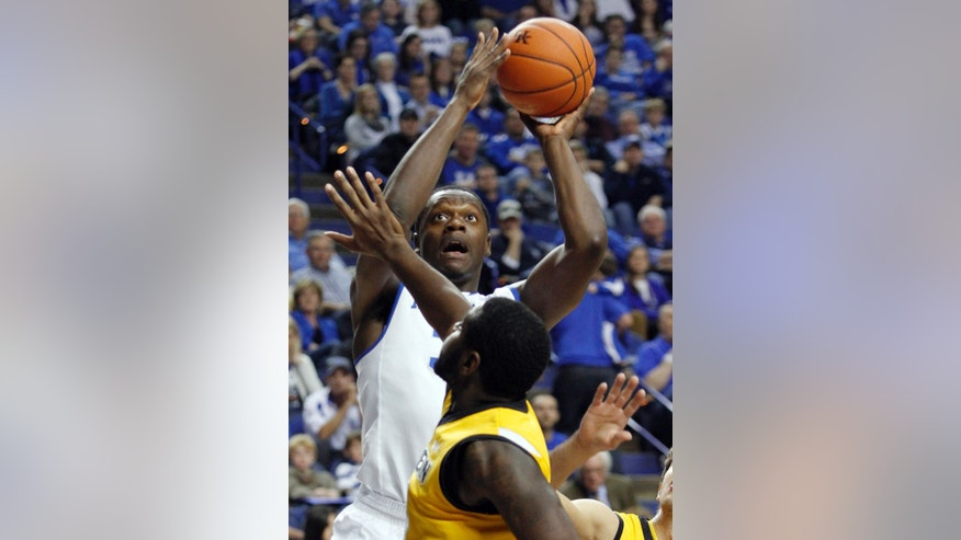 Kentucky's Julius Randle, top, shoots over Northern Kentucky's Jalen Billups during the first half of an NCAA basketball game, Sunday, Nov. 10, 2013, in Lexington, Ky. (AP Photo/James Crisp)