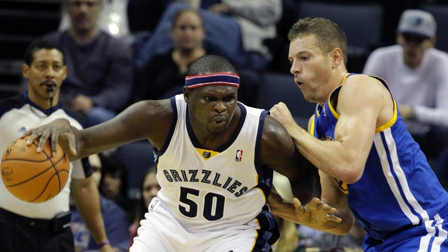 Memphis Grizzlies' Zach Randolph (50) dribbles the ball in front of Golden State Warriors' David Lee in the first half of an NBA basketball game in Memphis, Tenn., Saturday, Nov. 9, 2013. (AP Photo/Danny Johnston)