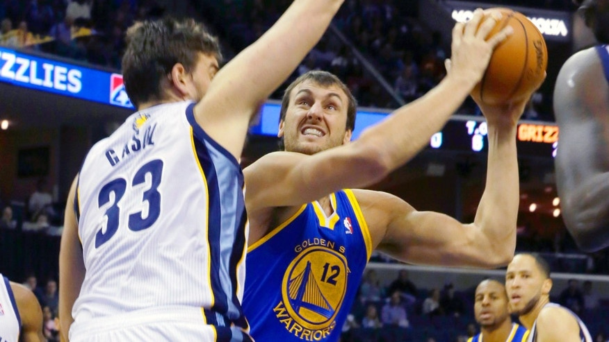 Memphis Grizzlies' Marc Gasol (33), of Spain, defends against Golden State Warriors' Andrew Bogut (12) , of Australia, in the first half of an NBA basketball game in Memphis, Tenn., Saturday, Nov. 9, 2013. (AP Photo/Danny Johnston)