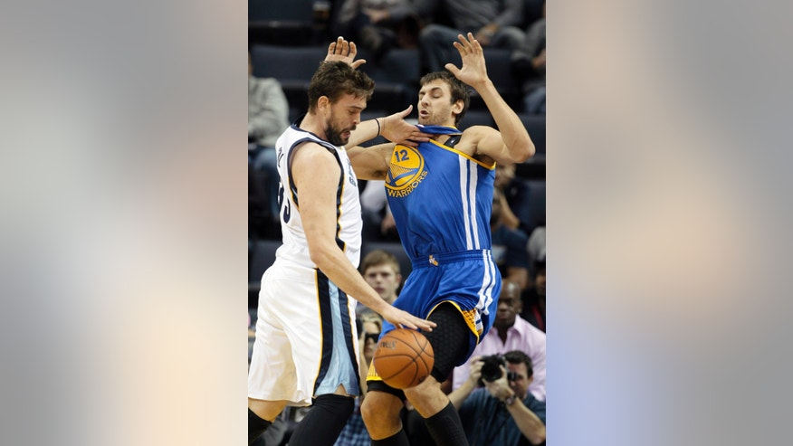 Golden State Warriors' Andrew Bogut (12) , of Australia, defends against Memphis Grizzlies' Marc Gasol, of Spain, left, in the first half of an NBA basketball game in Memphis, Tenn., Saturday, Nov. 9, 2013. (AP Photo/Danny Johnston)