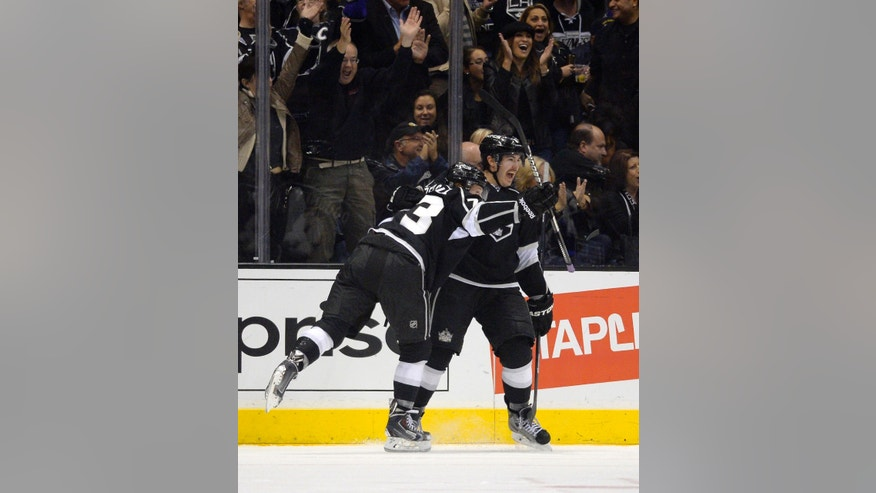 Los Angeles Kings center Tyler Toffoli, left, celebrates his goal with defenseman Drew Doughty during the first period of an NHL hockey game against the Vancouver Canucks, Saturday, Nov. 9, 2013, in Los Angeles.  (AP Photo/Mark J. Terrill)
