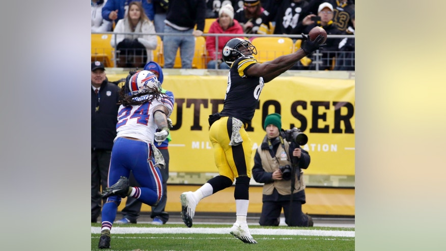 Pittsburgh Steelers' Jerricho Cotchery, right, pulls in a touchdown pass as Buffalo Bills' Stephon Gilmore trails during the first half of an NFL football game on Sunday, Nov. 10, 2013, in Pittsburgh. (AP Photo/Gene J. Puskar)