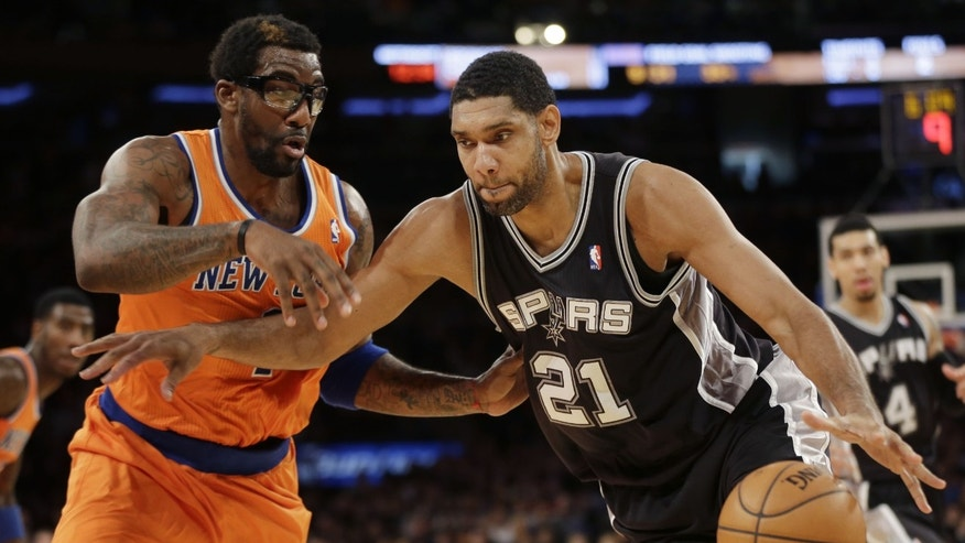 San Antonio Spurs' Tim Duncan, right, moves past New York Knicks' Amare Stoudemire during the first half of an NBA basketball game at Madison Square Garden, Sunday, Nov. 10, 2013, in New York. (AP Photo/Seth Wenig)