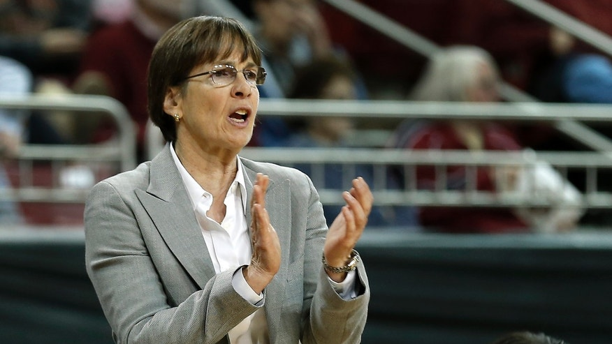 Stanford head coach Tara VanDerveer applauds her players during the second half of their 83-71 win over Boston College in an NCAA college basketball game at Conte Forum in Boston Saturday, Nov. 9, 2013. (AP Photo/Winslow Townson)
