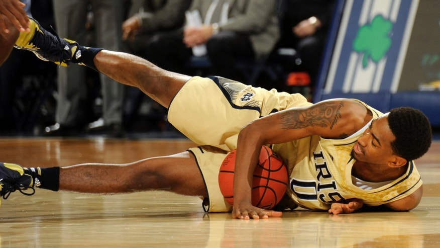 Notre Dame guard Eric Atkins grabs a loose ball during the first half of an NCAA college basketball game against Stetson, Sunday, Nov. 10, 2013, in South Bend, Ind. (AP Photo/Joe Raymond)