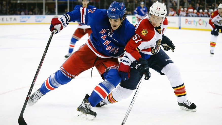 New York Rangers center Brian Boyle, left, and Florida Panthers defenseman Brian Campbell (51) battle for the puck in the second period of an NHL hockey game at Madison Square Garden, Sunday, Nov. 10, 2013, in New York. (AP Photo/John Minchillo)