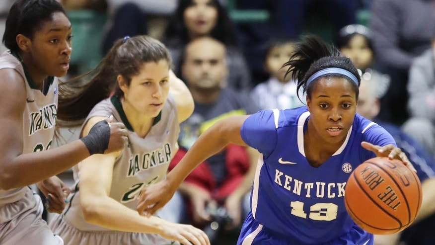 Kentucky's Bria Goss, right, is chased by Wagner's Ugo Nwaigwe, left, and Laura Amorosa in the first half of an NCAA college basketball game at Wagner College in the Staten Island borough of New York, Sunday, Nov. 10, 2013. (AP Photo/Mark Lennihan)