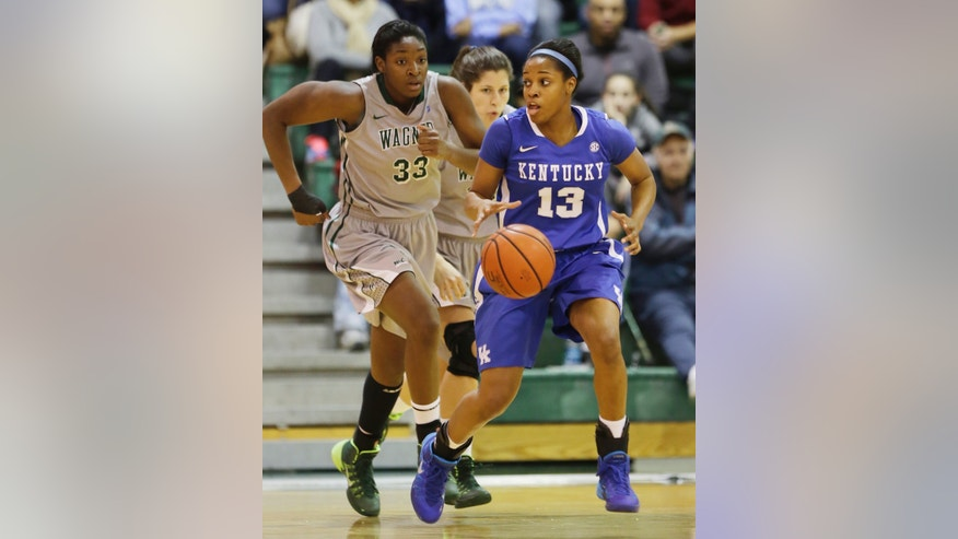 Wagner's Ugo Nwaigwe, left, chases Kentucky's Bria Goss in the first half of an NCAA college basketball game at Wagner College in the Staten Island borough of New York, Sunday, Nov. 10, 2013. (AP Photo/Mark Lennihan)