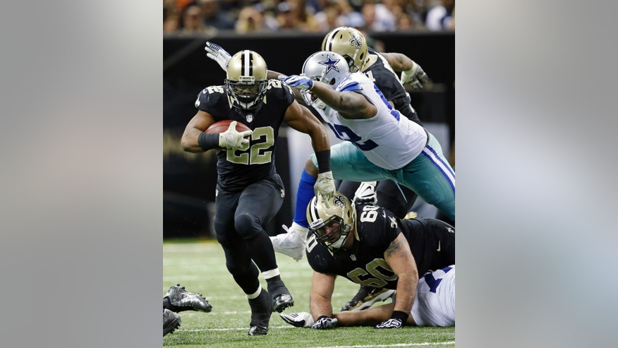 New Orleans Saints running back Mark Ingram (22) rushes past Dallas Cowboys defensive end Jarius Wynn (92) in the second half of an NFL football game in New Orleans, Sunday, Nov. 10, 2013. (AP Photo/Dave Martin)