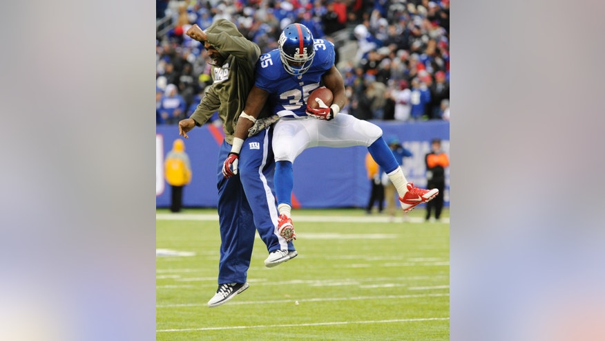 New York Giants running back Andre Brown, right, celebrates with running back Brandon Jacobs after scoring a touchdown against the Oakland Raiders during the second half of an NFL football game on Sunday, Nov. 10, 2013, in East Rutherford, N.J. (AP Photo/Bill Kostroun)