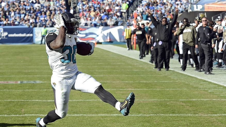 Jacksonville Jaguars running back Jordan Todman scores a touchdown on a 5-yard run against the Tennessee Titans in the third quarter of an NFL football game on Sunday, Nov. 10, 2013, in Nashville, Tenn. (AP Photo/Mark Zaleski)