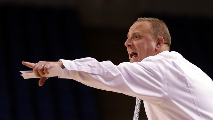 In this Nov. 6, 2013 photo, San Jose State coach Dave Wojcik gestures on the sideline during the basketball game against Pacific Union, in San Jose, Calif. (AP Photo/Ben Margot)