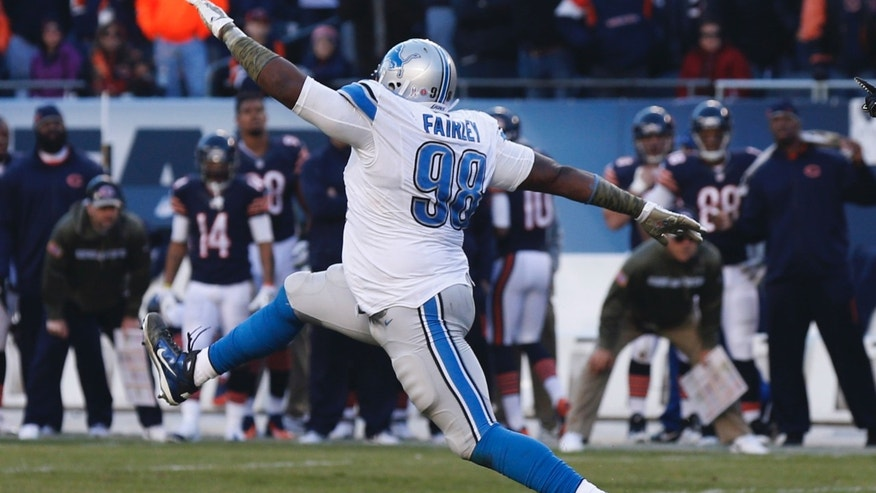 Detroit Lions defensive tackle Nick Fairley (98) celebrates after making a tackle against Chicago Bears during the second half of an NFL football game, Sunday, Nov. 10, 2013, in Chicago. The Lions won 21-19. (AP Photo/Charles Rex Arbogast)