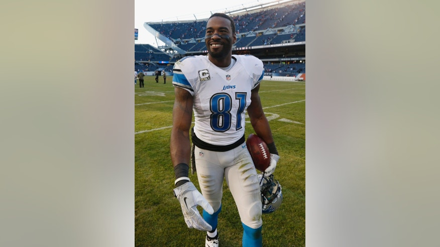 Detroit Lions wide receiver Calvin Johnson (81) smiles as he walks off the field after an NFL football game against the Chicago Bears, Sunday, Nov. 10, 2013, in Chicago. The Lions won 21-19. (AP Photo/Charles Rex Arbogast)