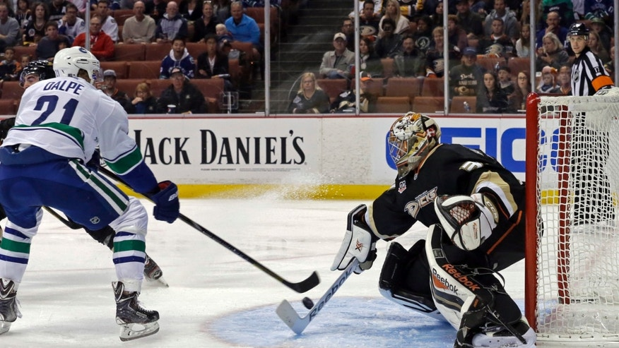 Anaheim Ducks goalie Frederik Andersen (31), of Denmark, defends as Vancouver Canucks center Zac Dalpe (21) shoots in the first period of an NHL hockey game in Anaheim, Calif., Sunday, Nov. 10, 2013. (AP Photo/Reed Saxon)