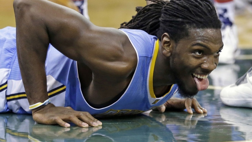 Denver Nuggets' Kenneth Faried looks up after being fouled in the second quarter during an NBA basketball game against the Utah Jazz Monday, Nov. 11, 2013, in Salt Lake City.  (AP Photo/Rick Bowmer)