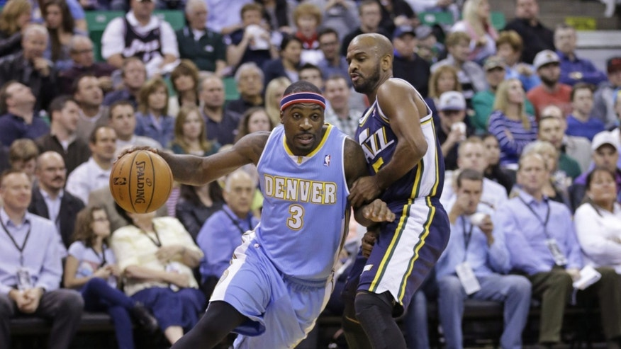 Denver Nuggets' Ty Lawson (3) drives around Utah Jazz's John Lucas III, right, in the first quarter during an NBA basketball game Monday, Nov. 11, 2013, in Salt Lake City.  (AP Photo/Rick Bowmer)