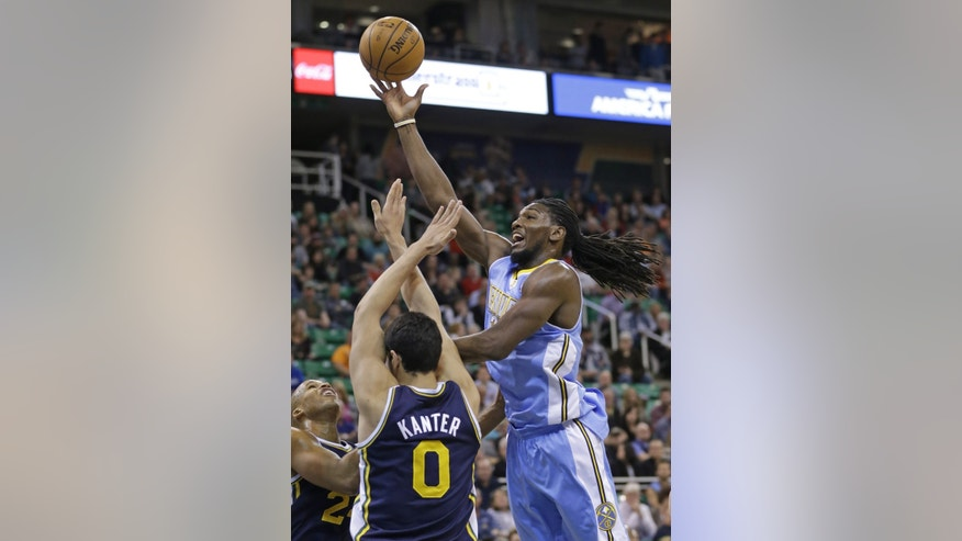 Denver Nuggets' Kenneth Faried, right, lays the ball up as Utah Jazz's Richard Jefferson, left, and teammate Enes Kanter (0), of Turkey, defend in the first quarter during an NBA basketball game Monday, Nov. 11, 2013, in Salt Lake City.  (AP Photo/Rick Bowmer)