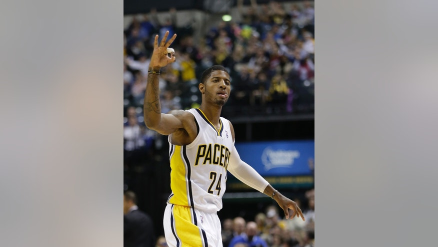 Indiana Pacers' Paul George reacts after hitting a 3-point shot during the second half of an NBA basketball game against the Toronto Raptors on Friday, Nov. 8, 2013, in Indianapolis. Indiana defeated Toronto 91-84. (AP Photo/Darron Cummings)