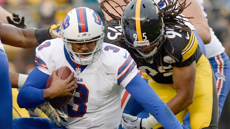 Buffalo Bills' EJ Manuel, left, is tackled by Pittsburgh Steelers' Jarvis Jones during the second half of an NFL football game, Sunday, Nov. 10, 2013, in Pittsburgh. (AP Photo/Don Wright)