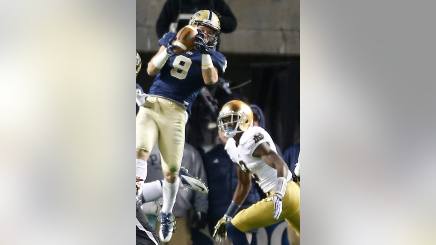 Pittsburgh defensive back Ray Vinopal (9) intercepts a pass intended for Notre Dame wide receiver Chris Brown (2) in the fourth quarter of an NCAA college football game on Saturday, Nov. 9, 2013, in Pittsburgh. Pittsburgh won 28-21.(AP Photo/Keith Srakocic)
