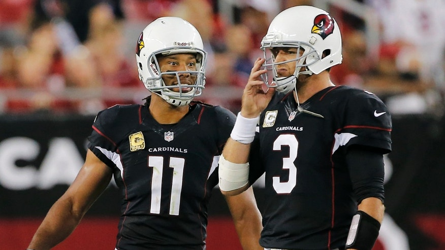 Arizona Cardinals wide receiver Larry Fitzgerald (11) talks with quarterback Carson Palmer (3) during the final minute of an NFL football game against the Houston Texans, Sunday, Nov. 10, 2013, in Glendale, Ariz. The Cardinals won 27-24. (AP Photo/Matt York)