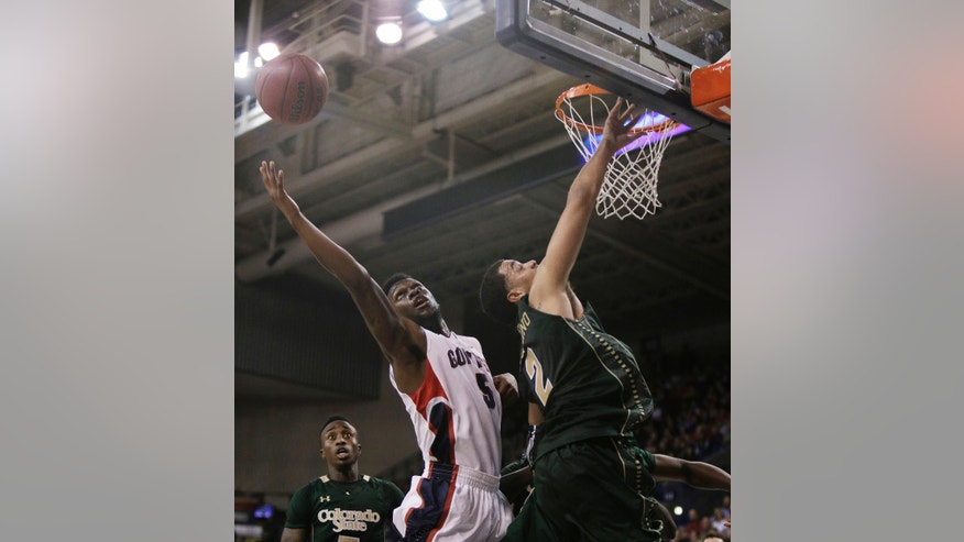 Gonzaga's Gary Bell, Jr. (5) and Colorado State's Daniel Bejarano (2) fight for a loose ball during the first half of an NCAA college basketball game, in Spokane, Wash., on Monday, Nov. 11, 2013. (AP Photo/Young Kwak)