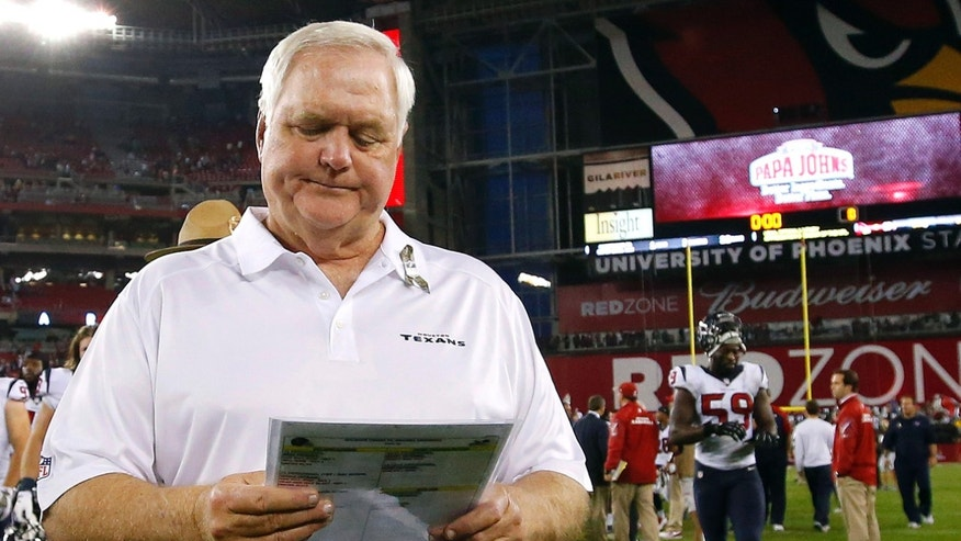 Houston Texans interim head coach Wade Phillips took the role after coach Gary Kubiak collapsed on the sidelines against Indianapolis, Nov. 3, 2013, with what was diagnosed as a mini-stroke, walks off the field after losing to the Arizona Cardinals during an NFL football game on Sunday, Nov. 10, in Glendale, Ariz. The Cardinals won 27-24. (AP Photo/Ross D. Franklin)