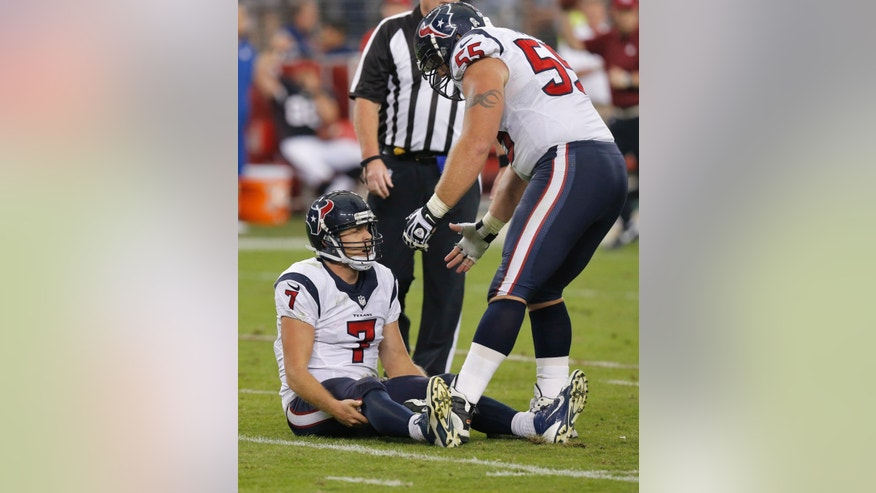 Houston Texans quarterback Case Keenum (7) is helped up by teammate Chris Myers (55) after being sacked during the second half of an NFL football game against the Arizona Cardinal, Sunday, Nov. 10, 2013, in Glendale, Ariz. (AP Photo/Ross D. Franklin)