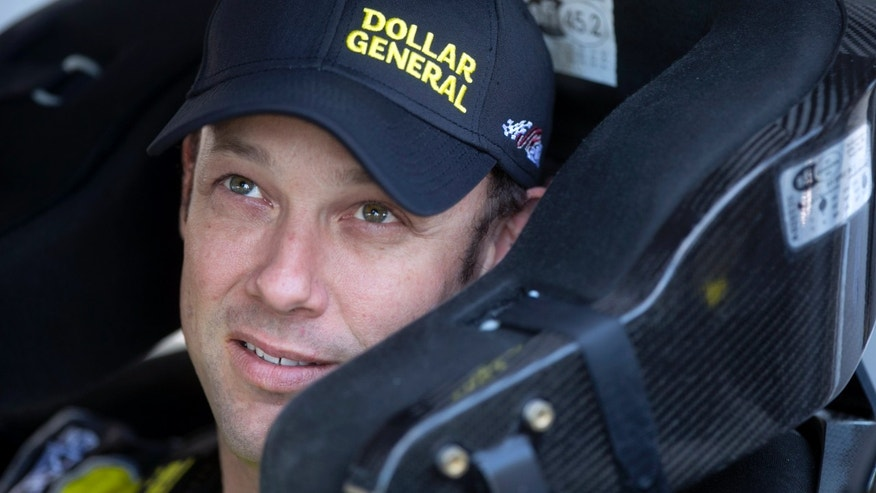 Matt Kenseth looks out from his car before qualifying for the NASCAR Sprint Cup Series auto race, Friday afternoon, Nov. 8, 2013, at Phoenix International Raceway in Avondale, Ariz. (AP Photo/The Arizona Republic. David Wallace) MARICOPA COUNTY OUT  NO SALES