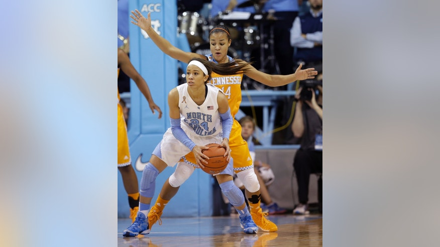 North Carolina's Jessica Washington (24) is pressured by Tennessee's Andraya Carter (14) during the first half of an NCAA college basketball game in Chapel Hill, N.C., Monday, Nov. 11, 2013. (AP Photo/Gerry Broome)