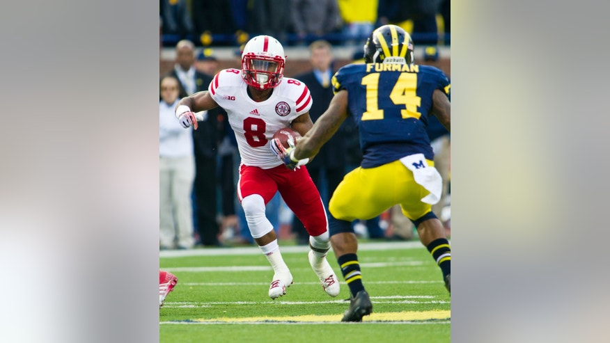 Nebraska running back Ameer Abdullah (8) rushes into coverage by Michigan safety Josh Furman (14) in the first quarter of an NCAA college football game in Ann Arbor, Mich., Saturday, Nov. 9, 2013. (AP Photo/Tony Ding)
