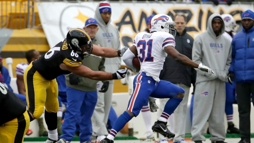 Buffalo Bills' Jairus Byrd, right, returns an interception as Pittsburgh Steelers guard David DeCastro (66) reaches for him during the first half of an NFL football game on Sunday, Nov. 10, 2013, in Pittsburgh. (AP Photo/Gene J. Puskar)