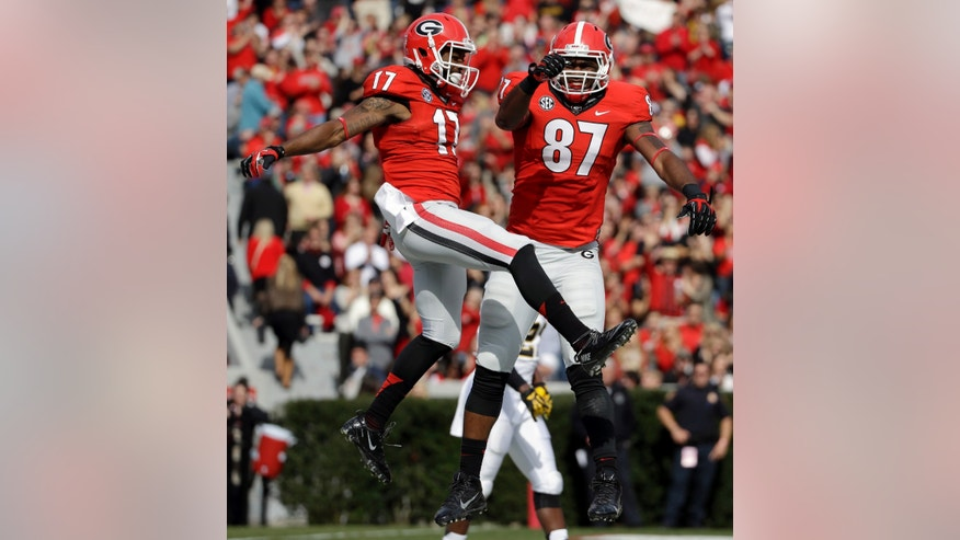Georgia's Rantavious Wooten, left, celebrates with teammate Jay Rome after Wooten scored a touchdown in the first quarter of an NCAA college football game against Appalachian State, Saturday, Nov. 9, 2013, in Athens, Ga. (AP Photo/David Goldman)