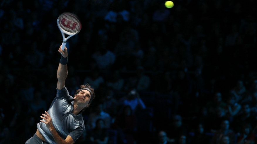 Roger Federer of Switzerland serves to Rafael Nadal of Spain during their ATP world Tour Finals tennis semifinal match at the O2 Arena on London, Sunday, Nov. 10, 2013. (AP Photo/Alastair Grant)